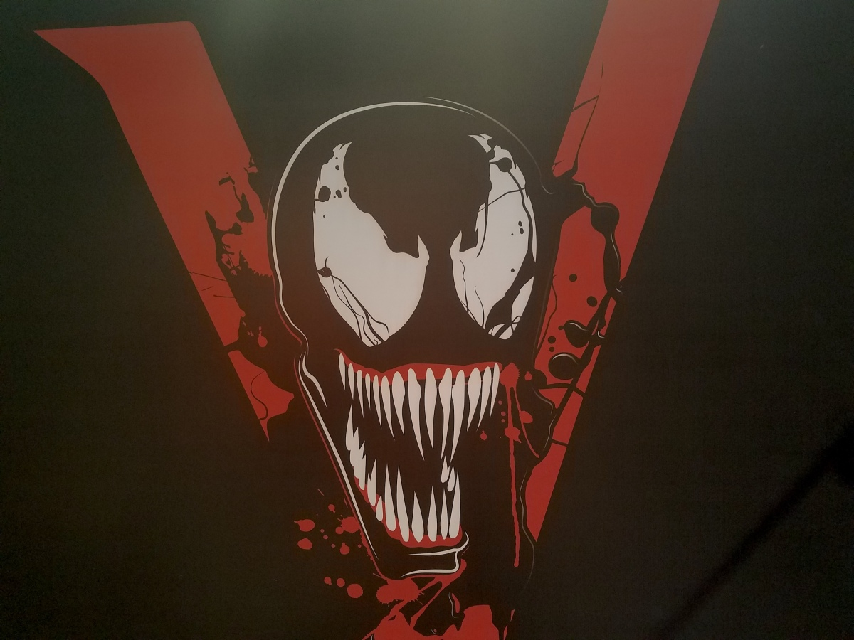 New Venom Banners Reveals The Film's Possible Eddie Brock's Costume Logo